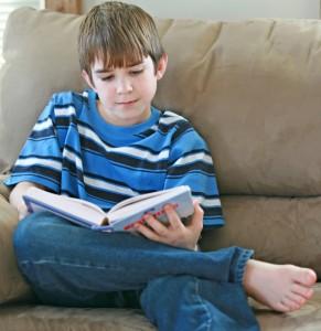 tween boy with book