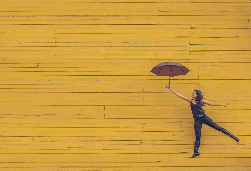 woman with umbrella-1245817_1920